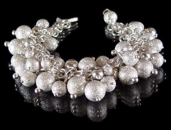 Ball and Chain bracelet in Sterling Silver by Liisa Gude Deberitz.